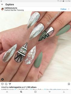 Olive green stiletto nails with glitter and black designs