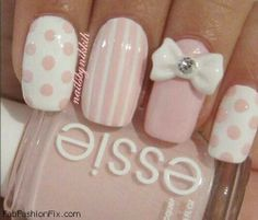 White and soft pink nails with bow