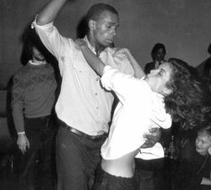 Bianca Jagger dances wildly with Sterling St. Jacques at Studio 54 on Jan. 10, 1978.