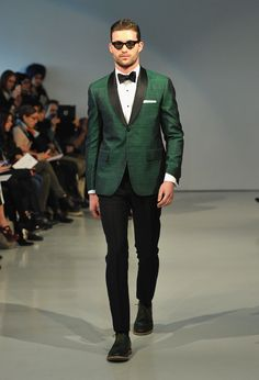 A  model walks the runway in a green tuxedo jacket at the David Hart Fall 2013 fashion show during Mercedes-Benz Fashion Week Fall 2013,