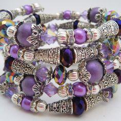 Memory Wire Bracelets  Memory Wire Cuff  Crystal Bracelets  Silver and Purple  Bracelet. $35.00, via Etsy.
