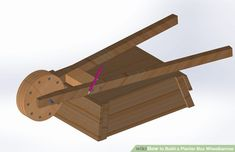 How to Build a Planter Box Wheelbarrow: 14 Steps (with Pictures) Wood Pallet Planters, Tire Planters, Wooden Pallet Projects, Pallet Fence, Wooden Pallets, Pallet Wood, Wheelbarrow Planter, Planter Boxes, Dresser Kitchen Island