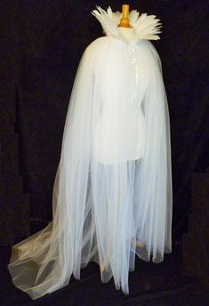 This cape is perfect for a glamorous bride wanting an alternative sheer tulle bridal cover-up. It will transform any dress or top into something White Witch Costume, White Queen Costume, Snow Queen Costume, Witch Dress, Tulle Costumes, Witch Costumes, Fairy Costumes, Ice Princess Costume, Wonderland Costumes