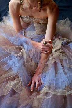 Tulle - A thin, fine, machine made net of acetate, nylon, rayon, or silk.