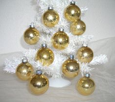 gold shiny brite Christmas ornaments - glass holiday balls - shabby cottage beach chic - hollywood regency - wreath garland tree supply by shesitsbytheseashore on Etsy