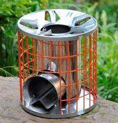 """Rocket Stove high efficiency wood burning stove, designed to accommodate multiple fuels when required outer cage remains cool to touch 10.5""""h x 9.5"""" 6.5lbs"""