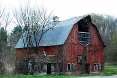 Beautiful old barn and small white building. Picture taken by Judy in SW Wisconsin Old Buildings, Abandoned Buildings, Abandoned Places, Farm Barn, Old Farm, Cattle Barn, Country Barns, Country Life, Country Roads