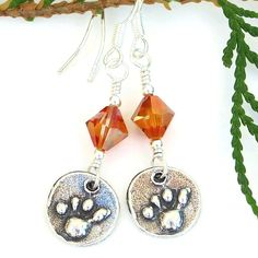 Even though the handmade MY FRIEND paw print dog rescue earrings are small, they pack a huge punch!  Sweet and sparkly, they will become your best friend if you love dogs, especially rescue dogs.