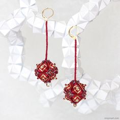 "English:These ""XiuQiu"" earrings are made of ""Caizongs"", traditional Chinese ornaments composed of folded paper and sewing threads that are reinterpreted in a contemporary wa..."