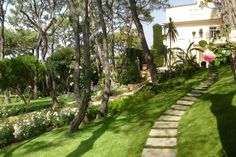 French Riviera. An exclusive park The green scenery of a historic residence.