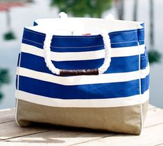 Wonderful monogrammed open boat made of canvas with rope handles. Blue and white stipe tote with brown bottom. Inside zippered pocket and a bottom insert for additional support. Bag measures x x and has a handle drop. Boat Bag, Boat Fashion, Cool Boats, Color Inspiration, Wedding Inspiration, Striped Canvas, Beach Bunny, Blue Stripes, Boating Fun