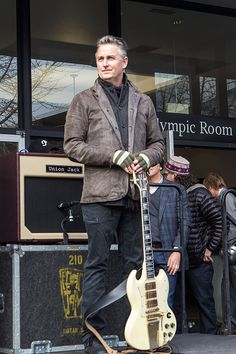 Guitarist Mike McCready of Pearl Jam plays a few notes to celebrate the ground…