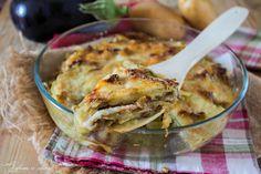 Tortino melanzane e patate filante un gustosissimo secondo piatto con melanzane fritte e patate, arricchito con scamorza, mozzarella e prosciutto cotto.