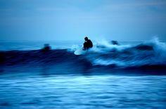 Surfing in blue