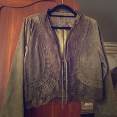 Sassy Suede Bolero Jacket You will definitely turn heads with this one. Olive green suede with matching color lace accents. Tie closure or not. Love this but haven't worn much at all so guess it's time to let someone else enjoy it. Jackets & Coats Jean Jackets