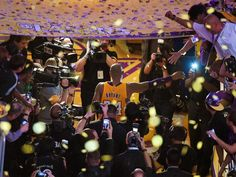 Kobe Bryant walks off the court after scoring 60 points in the final game of his career.