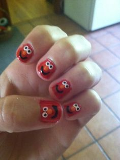 Elmo!  I will have to get my nails done in honor of Addi!  She would of loved these!