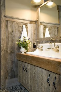 Love the molded sink, rough woods and lighting.