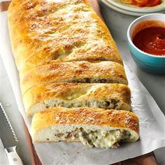 Cheesy Sausage Stromboli Recipe -I've had a hundred requests for this recipe over the years. Perfect for brunch or as an evening snack, this sausage-filled bread is not tricky to make...and I never have to worry about storing leftovers! -Vada McRoberts, Silver Lake, Kansas