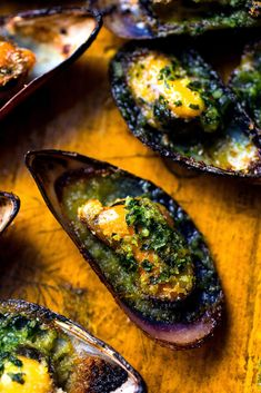Broiled Mussels With Garlicky Herb Butter Recipe - NYT Cooking - Deringa Fish Dishes, Seafood Dishes, Fish And Seafood, Seafood Recipes, Gourmet Recipes, Cooking Recipes, Healthy Recipes, Green Mussels, French Tips