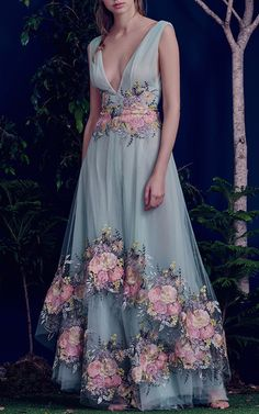 Meet the gowns you grow up dreaming about in Al Fahim's latest collection. Her hand-painted florals, ribbon embroidery, and layer upon layer of tulle paint an ethereal picture for Fall / Winter. Your fairytale starts here.