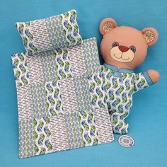 You need three, 8 inch x 8 inch swatches to make the quilt and pillow. Turn the stripes in different directions to add interest. Cut all the swatches into 2 inch x 4 inch blocks. Use 18 blocks for the quilt top. Use 4 blocks for the pillow front. Add batting and backing for the quilt and backing and stuffing for the pillow.  With ¼ inch seam allowances, the finished quilt measures about 9 inches wide x 10 ½ inches long. The finished pillow measures about 3 inches x 5 ½ inches.