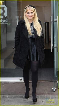 Meghan Trainor heads out of Global House in a chic black ensemble in London on Thursday morning (January 22).