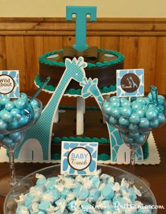 decorate the dessert table with a turquoise and brown baby shower theme perfect for a