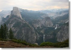Half Dome seen from Washburn Point (NOTE: Short 20 stair walk on the way to Glacier Point.  The views here are similar to the views at Glacier Point, but from a more southerly perspective. You won't be able to see Yosemite Falls from here, and you'll see Half Dome edge-on instead of seeing its face. You will have a better view of Illilouette Falls here - and if you brought binoculars, it's probably a better view than you'll get from the Illilouette Falls trail itself.)