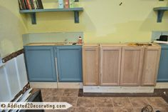 diy bookcase media wall, diy, painted furniture, shelving ideas, woodworking projects, I used stock wall cabinets 12 deep from Home Depot as lower cabinets so I had to build a base for them I was reusing some cabinets from a previous media wall attempt that didn t turn out so great which is why they re painted