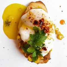 On my toast: Spicy Quick sautéed red onion, garlic and elote, poached egg and chili de arbol oil, sea salt and coarse pepper.  by holasus