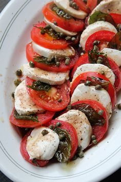 Caprese Salad with Fried Capers and Basil by Saveur. Briny and slightly crispy fried capers punch up the flavor of this classic Italian tomato and mozzarella salad. Basil Recipes, Salad Recipes, Italian Dishes, Italian Recipes, Vegetarian Recipes, Cooking Recipes, Healthy Recipes, Caprese Salat, Salada Caprese