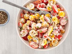 Cherry Tomato Salad With Buttermilk-Basil Dressing Recipe : Patrick and Gina Neely : Food Network.  Maybe also some mozarella cheese cubes