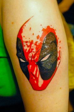 fuckyeahtattoos: My Deadpool tattoo/cover up. Wade Wilson is my absolute favorite Marvel character. Underneath him is a half-removed Nightcrawler (it was done horribly). I would have needed a skin graft because of how deep the ink was. So instead, I replaced him with Deadpool. The grey may look a little wonky, but my skin wasn't accepting it, so after it heals, I'm going to get it touched up. I'm still in love with it, though! Done by Lalo at Konvikted Ink in Dallas, TX
