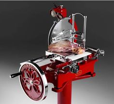 Berkel slicer... it's hand powered but it slices perfect thin cuts better than any electric slicer i've ever used.