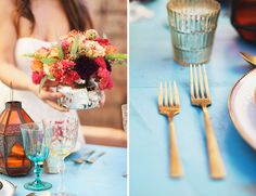 Bright red and orange flowers create the perfect centerpiece, while gold flatware adds an elegant touch