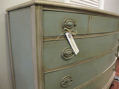 """The Mended Nest: Mended Furniture -""""I started by painting the whole dresser in ASCP Paris Grey & drawers (& sides of dresser) in Provence...added a border of Provence on the top of dresser. After applying a few coats, went over the whole thing with a mixture of French Linen & water, wiping excess with old shirt...allowed  original color to bleed through with a washed/cloudy effect. After it dried, I distressed it a little and applied both clear and dark waxes to seal the paint."""""""