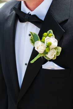 Kirstin & Evan | Wedding in Tampa Bay | White and greenery boutonniere. #andrealaynefloraldesign #tampaweddings