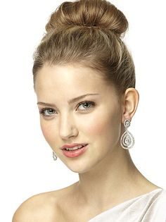 Dramatic CZ chandelier earrings with large teardrop shaped CZ nested inside bezel set bezel set accents. Set in brass plated with hyperallergenic rhodium.    http://www.dessy.com/accessories/cz-nested-drop-earrings/