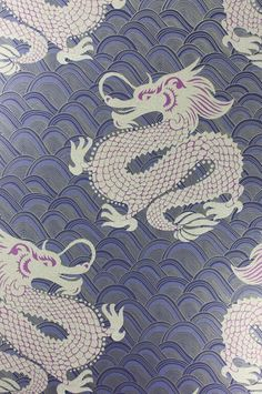 Celestial Dragon Wallpaper An oriental inspired wallpaper designed by Matthew Williamson featuring an imperial Chinese dragon in metallic antique gold beads and amethyst surrounded by swirling dark violet hoops.