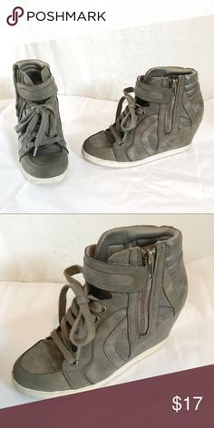 Army Green/Gray Sneaker Wedge. Size 7 Cute sneaker like heels that lace up. Size 7. Cute with a pair of skinny jeans, leggings or with a skirt. Lace up design with a zipper on the side Candie's Shoes