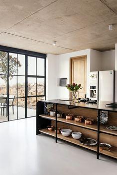 Industrial Style Architect's House created by Nadine Engelbrecht in South Africa using a barn as inspiration Stunning wooden island acts as a central hub of the kitchen space Industrial Kitchen Design, Interior Design Kitchen, Industrial Style, Minimal Kitchen Design, Industrial Windows, Industrial Interiors, Modern Interior, Küchen Design, Layout Design