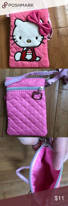 Hello Kitty Soft Mobile Phone Bad Handbag Purse Size 11.5 cm ( L) X 17. 5 cm (H). 4.5 inch x 7 inches . iPhone 6, 6 plus , Samsung , coin , Keychain more size . Material : polyester + PU Hello Kitty Accessories