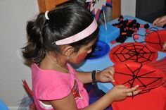 """WEB SPINNING"" was a fun, indoor craft activity, in which the children wove their own Spiderman spider webs using black wool and paper plates!!"