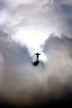 Couldn't you just imagine Jesus coming through the clouds? Beautiful capture of the famous statue in Rio de Janeiro Brazil .Cristo Redentor by John Dalkin - Beautiful World, Beautiful Places, Beautiful Pictures, Heaven Pictures, The Places Youll Go, Places To Go, Christ The Redeemer Statue, Jesus Christ, Risen Christ