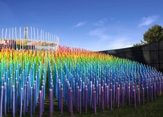 over 1,500 locally sourced bamboo poles have been cut to specific lengths, creating a composition of light and color that conveys movement and playfulness.