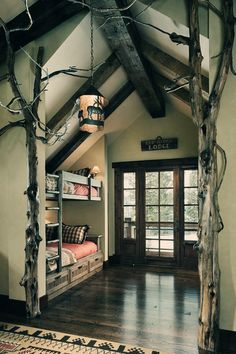 Lodge bedroom with bunk beds and interior tree decoration. Bunk Rooms, Bunk Beds, Loft Beds, Lodge Bedroom, Forest Bedroom, Woodsy Bedroom, Rustic Bedrooms, Bedroom Retreat, Sweet Home