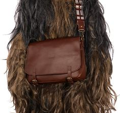 Indulge in your love of everyone's favorite fuzzball with the Star Wars Chewbacca Messenger Bag ($90).