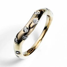 Contour Starburst Wedding Band by Rebecca Zemans made out of 14K yellow gold with flush set diamonds.