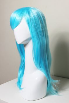 Long Straight Aqua cosplay wig ideal for any cosplay, rave, Halloween or dress up occasion. Wig is made out of heat resistant fiber and is super light and soft. It makes an amazing gift for friends, family and it fits women and children 6 and up. Please be aware that colors might look slightly different in person due to camera quality and monitor settings. Stock photos are taken in natural light with no flash.   It is recommended to fluff and run fingers through wig to get out loose fibers…